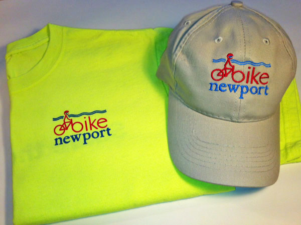 Photograph of t-shirt and hat with Bike Newport logo.